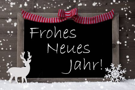 jahr: Gray Christmas Card With Chalkoard, Red Loop, Reindeer And Snowflakes On White Snow. Rustic Wooden Background. Decoration With German Text Frohes Neues Jahr Mean Happy New Year. Black And White Image