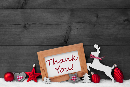 like english: Gray Christmas Card With Picture Frame On White Snow, Sparkling Stars. English Text Thank You. Red Christmas Decoration Like Balls, Tree And Reindeer. Wooden, Vintage Background. Black And White Stock Photo
