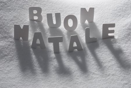 buon: White Letters Building Italian Text Buon Natale Means Merry Christmas On White Snow. Snowy Landscape Or Scenery. Christmas Card For Seasons Greetings Or Usable As Background. Stock Photo
