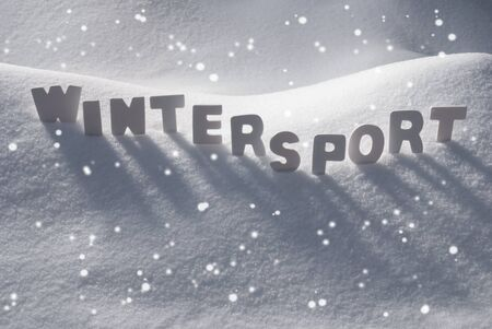 wintersport: White Letters Building English Text Wintersport On White Snow. Snowy Landscape Or Scenery With Snowflakes. Christmas Card For Seasons Greetings Or Usable As Background.