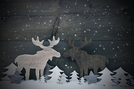 realtionship: Gray  Vintage Christmas Card Or Decoration, Moose Couple In Love On White Snow And Christmas Tree. Snowflakes And Sparkling Stars. Rustic, Vintage Wooden Background. Black And White Image