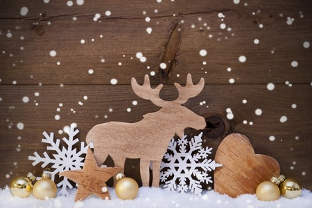golden heart: Christmas Card With Golden Festive Decoration On Snow. White Moose, Christmas Ball, Hear, Snowflakes, Star. Brown, Rustic, Vintage Wooden Background. Copy Space For Advertisement
