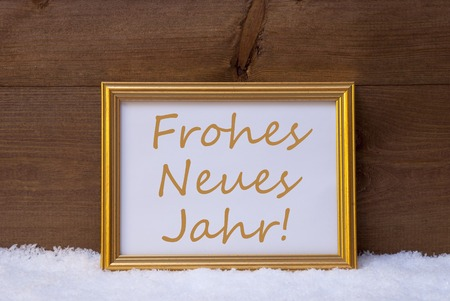 jahr: One Golden Retro Picture Frame On Snow. Christmas Card With German Text Frohes Neues Jahr Means Happy New Year. Rustic, Wooden, Brown Aand Vintage Background.