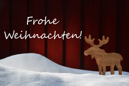 weihnachten: Christmas Card With White Snow And Moose. German Text Frohe Weihnachten Mean Merry Christmas. Snowy Scenery And Atmosphere. Rustic Vintage Wooden Background