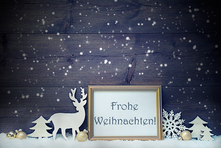 weihnachten: Vintage Christmas Card With Picture Frame On Snow. German Text Frohe Weihnachten Means Merry Christmas. White Decoration Like Snowflakes, Tree, Golden Ball And Reindeer. Shabby Chic, Wooden Background