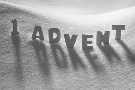White Letters Building German Text 1 Advent Means Christmas Time On White Snow. Snowy Landscape Or Scenery. Christmas Card For Seasons Greetings Or Usable As Background. Standard-Bild