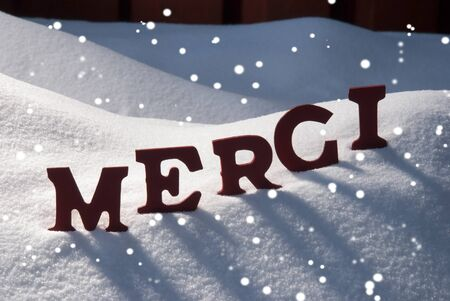 red letters on white snow with snowflakes as christmas card french text or word merci - What Does The Word Christmas Mean