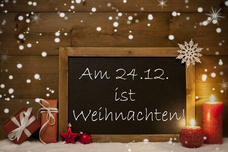 weihnachten: Festive Christmas Card With Chalkboard, Red Gifts, Christmas Balls, Snowflakes And Candles. Christmas Decoration With Vintage Wooden Background. German Text Am 24.12 Ist Weihnachten Mean Christmas Stock Photo