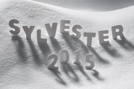 sylvester: White Letters Building German Text Sylvester 2015 Means New Years Eve 2015 On White Snow. Snowy Landscape Or Scenery. Christmas Card For Seasons Greetings Or Usable As Background.