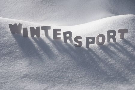 wintersport: White Letters Building English Text Wintersport On White Snow. Snowy Landscape Or Scenery. Christmas Card For Seasons Greetings Or Usable As Background. Stock Photo