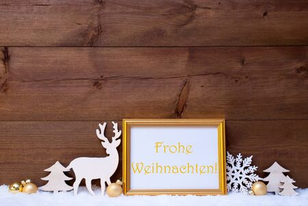 weihnachten: Christmas Card With Picture Frame On White Snow. German Text Frohe Weihnachten Means Merry Christmas. White Decoration Like Snowflake, Tree, Golden Balls And Reindeer. Vintage, Wooden Background Stock Photo
