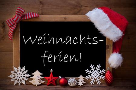 christmas time: Blackboard With Red Santa Hat And Christmas Decoration like Snowflake