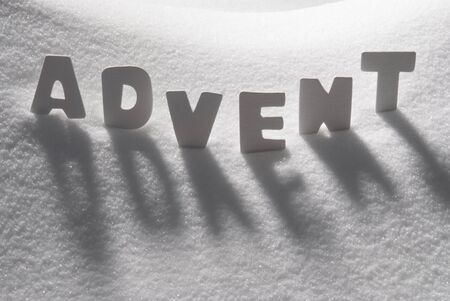 advent season: White Letters Building German Text Advent Means Christmas Time On White Snow