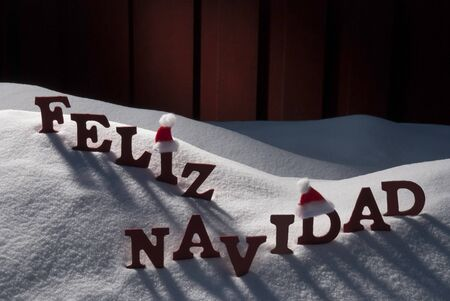 feliz navidad: Red Letters With Santa Hat On White Snow As Christmas Card
