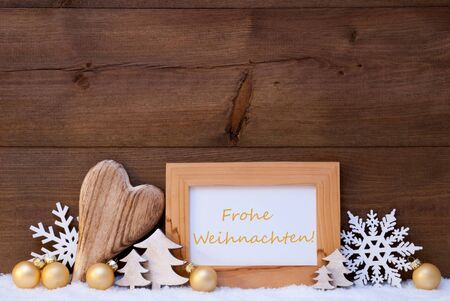 frohe: Golden Christmas Decoration On Snow. Heart, Christmas Tree Balls, Snowflake, Christmas Tree. Picture Frame With German Text Frohe Weihnachten Mean Merry Christmas. Rustic, Vintage Wooden Background. Stock Photo