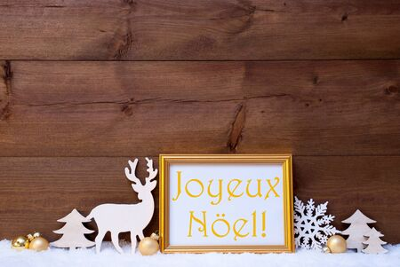 joyeux: Christmas Card With Picture Frame On White Snow. FrenchText Joyeux Noel Means Merry Christmas. White Decoration Like Snowflake, Tree, Golden Balls And Reindeer. Vintage, Wooden Background Stock Photo