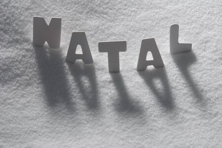 natal: White Letters Building Portuguese Text Natal Means Christmas On White Snow. Snowy Landscape Or Scenery. Christmas Card For Seasons Greetings Or Usable As Background.