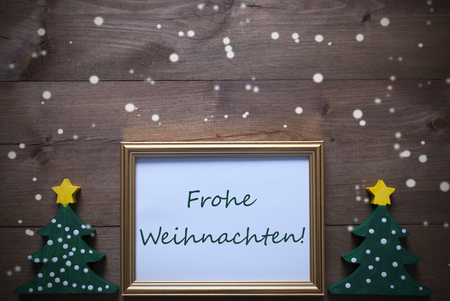 weihnachten: One Golden Picture Frame With Two Green Christmas Tree. German Text Frohe Weihnachten Means Merry Christmas. Christmas Card For Seasons Greetings. Decoration Rustic Background And Snowflakes