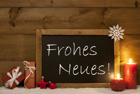 neues: Festive Christmas Card With Chalkboard, Red Gifts, Christmas Balls, Snowflake And Candles. Christmas Decoration With Vintage Wooden Background. German Text Frohes Neues Mean Happy New  Year