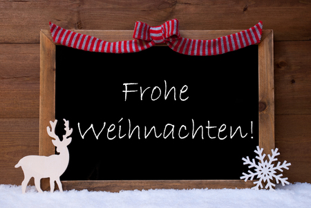 frohe: Brown Christmas Card With Chalkoard, Red Loop, Reindeer And Snowflake On White Snow. Rustic Wooden Background. Decoration With German Text Frohe Weihnachten Mean Merry Christmas.