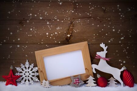reindeer: Christmas Card With Picture Frame On Snow. Copy Space For Advertisement. Red Christmas Decoration Like Christmas Ball, Snowflakes, Tree, Star And Reindeer. Wooden And Vintage Background
