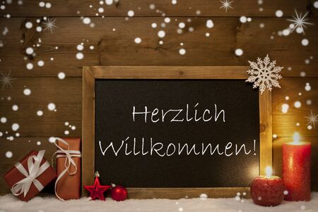 willkommen: Festive Christmas Card With Chalkboard, Red Gifts, Christmas Balls, Snowflakes And Candles. Christmas Decoration With Vintage Wooden Background. German Text Herzlich Willkommen Mean Welcome