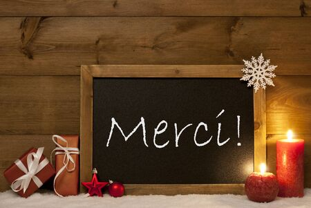 merci: Festive Christmas Card With Chalkboard, Red Gifts, Christmas Balls, Snowflake And Candles. Christmas Decoration With Vintage Wooden Background. FrenchText Merci Mean Thank You