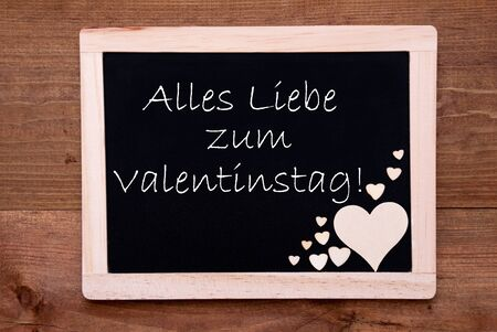 Liebe: Blackboard With German Text Alles Liebe Zum Valentinstag Means Happy Valentines Day. Brown Wooden Hearts. Wooden Background With Vintage, Rustic Or Retro Style.