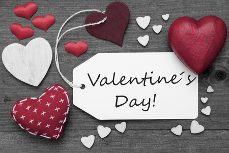 hot spot: Label With Red Textile Hearts On Wooden Gray Background. English Text Valentines Day. Retro Or Vintage Style. Black And White Image With Colored Hot Spot.