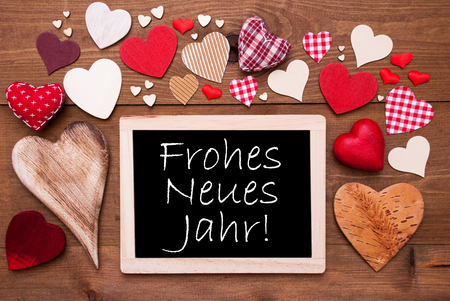 neues: Chalkboard With German Frohes Neues Jahr Means Happy New Year. Many Red Textile Hearts. Wooden Background With Vintage, Rustic Or Retro Style.