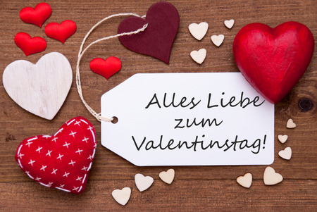 in liebe: Label With Red Textile Hearts On Wooden Background. German Text Alles Liebe Zum Valentinstag Means Happy Valentines Day. Retro Or Vintage Style Stock Photo
