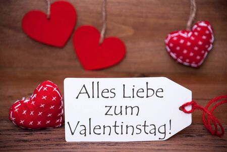 in liebe: One White Label With German Text Alles Liebe Zum Valentinstag Means Happy Valentines Day. Romantic Decoration With Red Hearts For Valentines Day. Rustic Or Retro Style