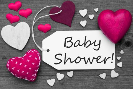 hot spot: Label With Pink Textile Hearts On Wooden Gray Background. English Text Baby Shower. Retro Or Vintage Style. Black And White Image With Colored Hot Spot. Stock Photo