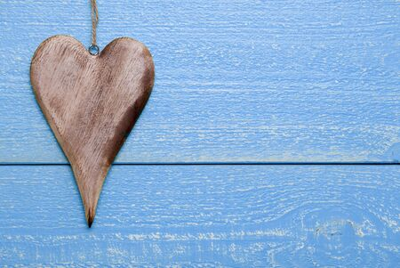 free backgrounds: One Heart On Blue Wooden Background. Greeting Card For Valentines Day. Copy Space For Advertisement. Rustic, Retro Or Vintage Style