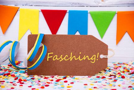fasching: Label With German Text Fasching Means Carnival. Party Decoration Like Streamer, Confetti And Bunting Flags. White Wooden Background With Vintage, Retro Or Rustic Syle