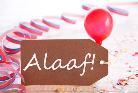 fasching: One Label With German Text Alaaf Means Carnival. Party Decoration Like Streamer, Confetti And Balloon. Wooden Background With Vintage, Retro Or Rustic Syle Stock Photo