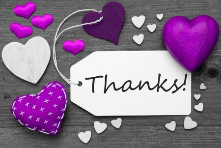 hot spot: Label With Purple Textile Hearts On Wooden Gray Background. English Text Thanks. Retro Or Vintage Style. Black And White Image With Colored Hot Spot. Stock Photo