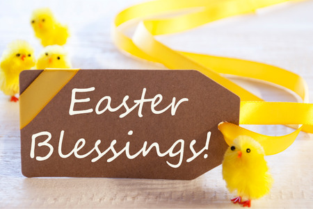 blessings: One Brown Label With Yellow Ribbon And Chicks. English Text Easter Blessings. Card For Easter Greetings On Wooden Background Stock Photo