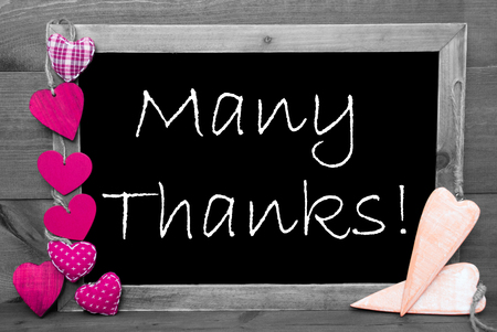many thanks: Chalkboard With English Text Many Thanks And Pink Hearts. Wooden Background With Vintage, Rustic Or Retro Style. Black And White Image With Colored Hot Spots.