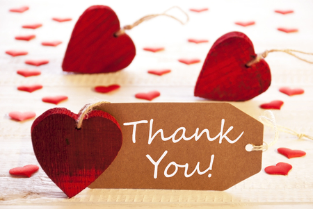 many thanks: Romantic Label With Many Hearts. English Text Thank You. Wooden Background And Retro Or Vintage Style.