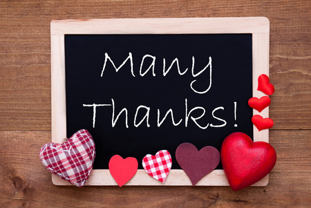 many thanks: Blackboard With English Text Many Thanks. Red Textile Hearts. Stock Photo