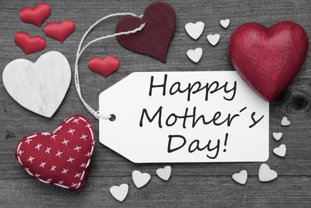 hot spot: Label With Red Textile Hearts On Wooden Gray Background. English Text Happy Mothers Day. Retro Or Vintage Style. Black And White Image With Colored Hot Spot.