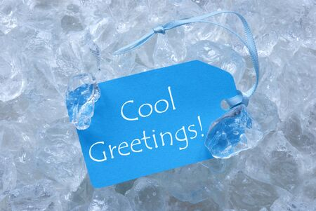 text cool: Light Blue Label With Blue Ribbon On White Transparent Curshed Ice Cubes As Background. English Text Cool Greetings.Close Up Or Macro View.