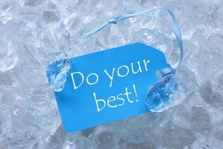 up do: Light Blue Label With Blue Ribbon On White Transparent Curshed Ice Cubes As Background. English Quote Do Your Best For Cool Greetings.Close Up Or Macro View.