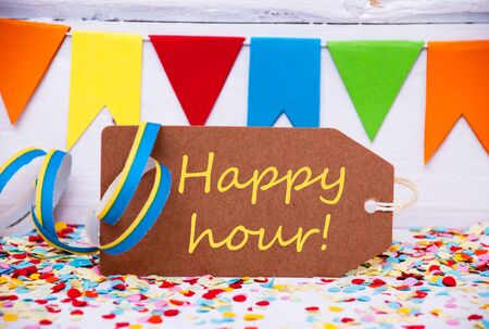 like english: Label With English Text Happy Hour. Party Decoration Like Streamer, Confetti And Bunting Flags. White Wooden Background With Vintage, Retro Or Rustic Syle