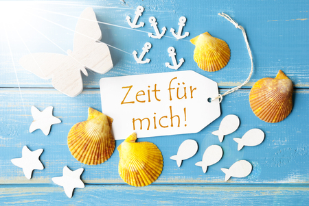 butterflies for decorations: Flat Lay View Of Label With German Text Zeit Fuer Mich Means Time For Me. Sunny Summer Greeting Card. Butterfly, Shells And Fishes On Blue Wooden Background Stock Photo