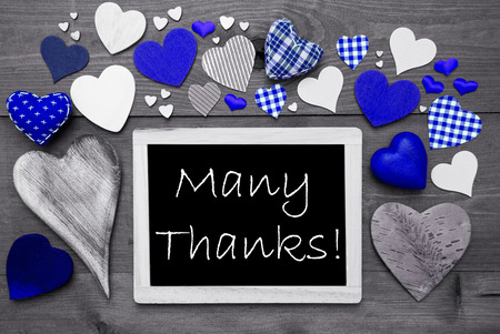 many thanks: Chalkboard With English Text Many Thanks. Many Blue Textile Hearts. Grey Wooden Background With Vintage, Rustic Or Retro Style. Black And White Style With Colored Hot Spots