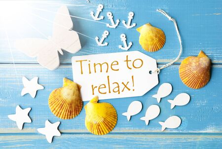 downtime: Flat Lay View Of Label With English Text Time To Relax. Sunny Summer Greeting Card. Butterfly, Shells And Fishes On Blue Wooden Background