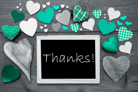 many thanks: Chalkboard With English Text Thanks. Many Green Textile Hearts. Grey Wooden Background With Vintage, Rustic Or Retro Style. Black And White Style With Colored Hot Spots