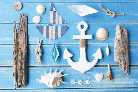 nautic: Flat Lay Of Chalkboard On Blue Wooden Background. Nautic Or Maritime Summer Decoration As Holiday Greeting Card.